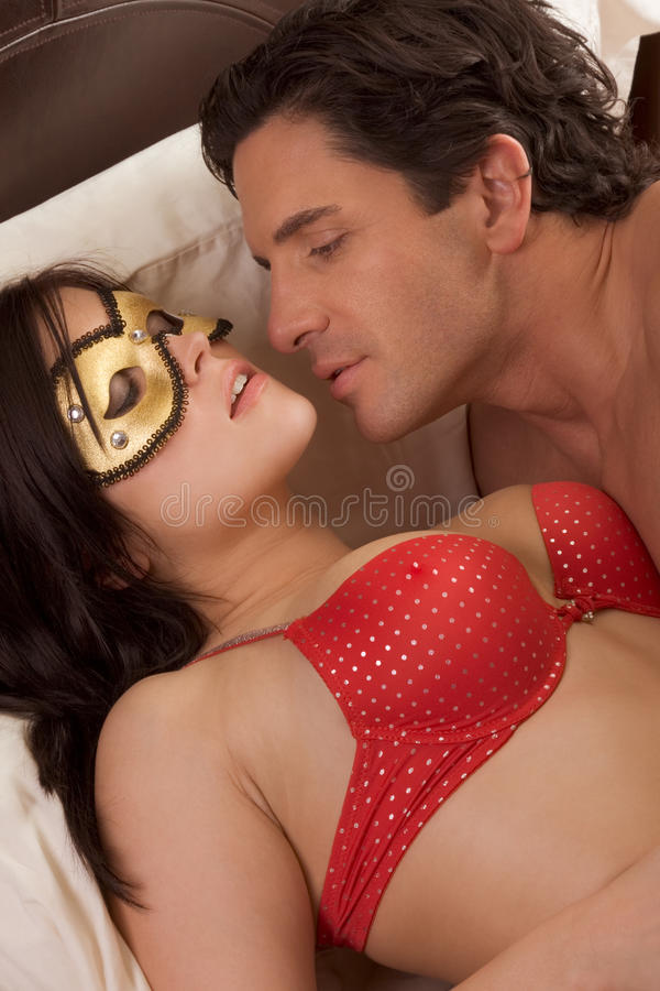 Mysterious Woman In Fetish Mask Seducing Man Stock Images