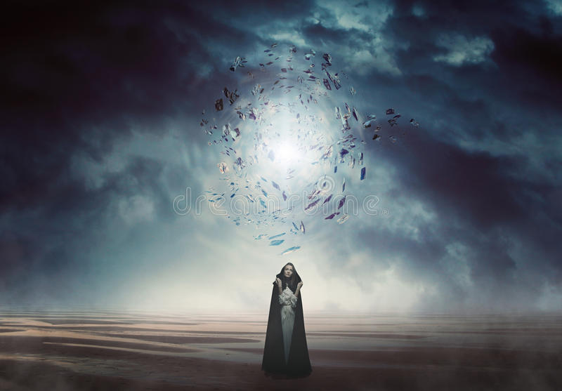 Mysterious woman in a magical and strange land stock photo