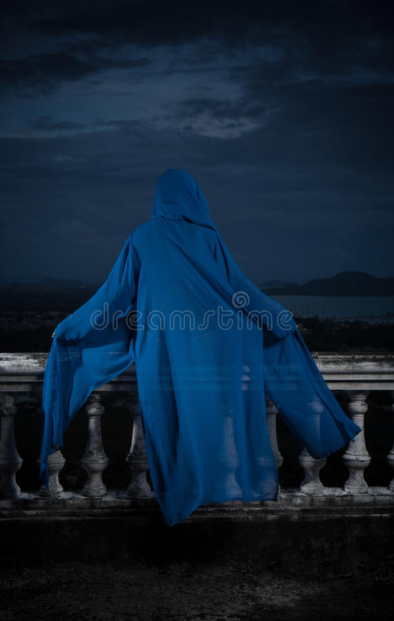 Mysterious woman over cloudy sky and cityscape stock images