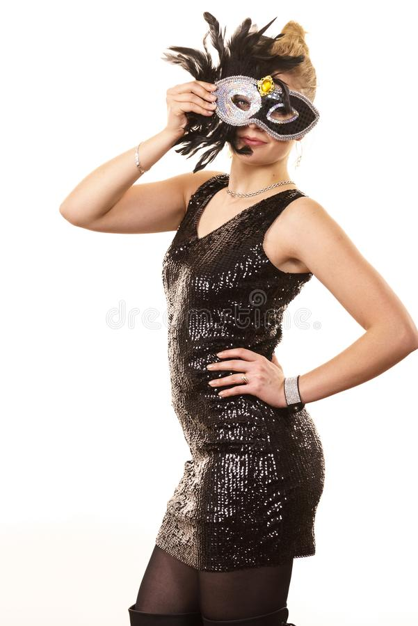 Mysterious woman wearing carnival mask royalty free stock photography