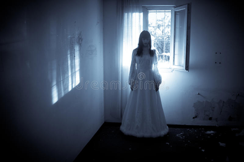 Mysterious Womans Ghost. Horror Scene of a Black Long Hair Scary Woman stock photo