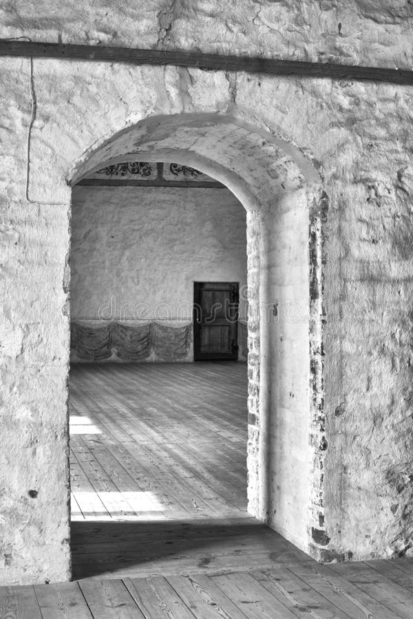 Mysterious wooden door in old castle stock image
