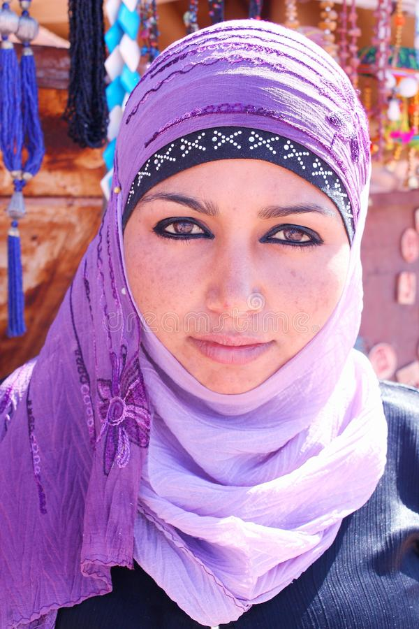 Mysterious young Jordanian woman wearing a violet veil over her hair. stock photography