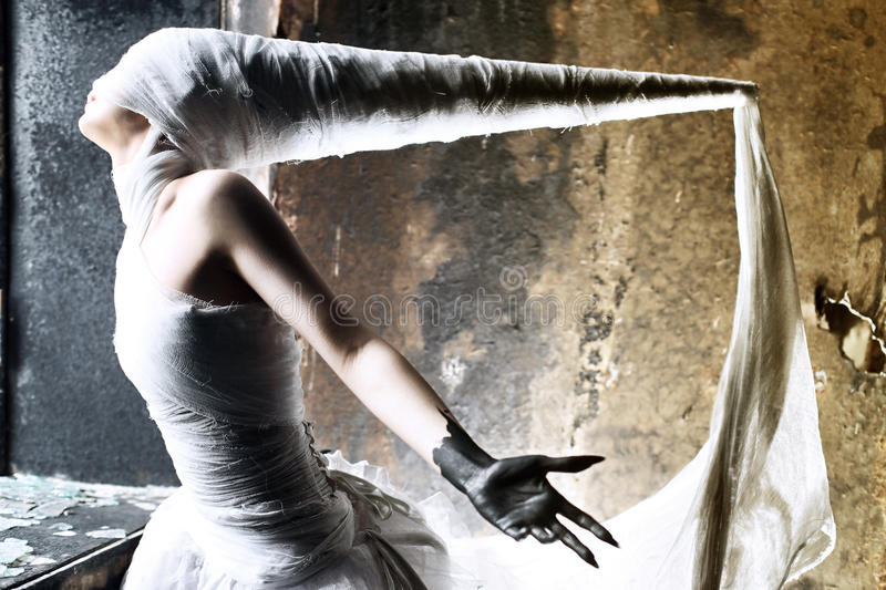 Mystery. Shot of a twilight girl in white dress. Halloween, horror royalty free stock image