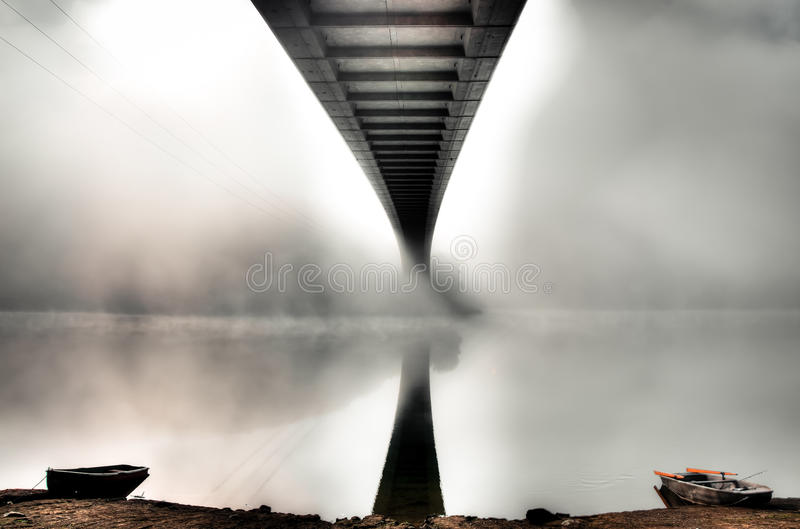 Mystery bridge with two boats royalty free stock image