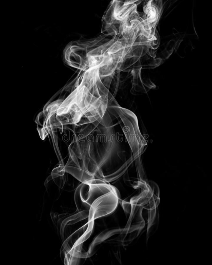 Mystery dense smoke over black background, abstract photo stock images