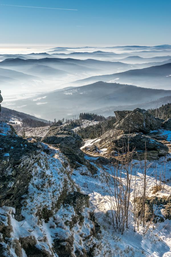 Mystery mountains in the winter from rocks stock photo