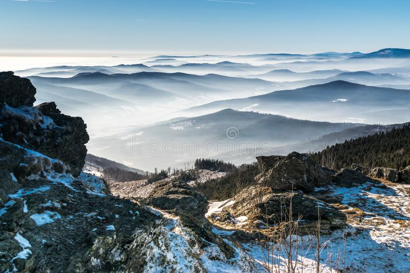 Mystery mountains in the winter. With the view from rocks royalty free stock photos