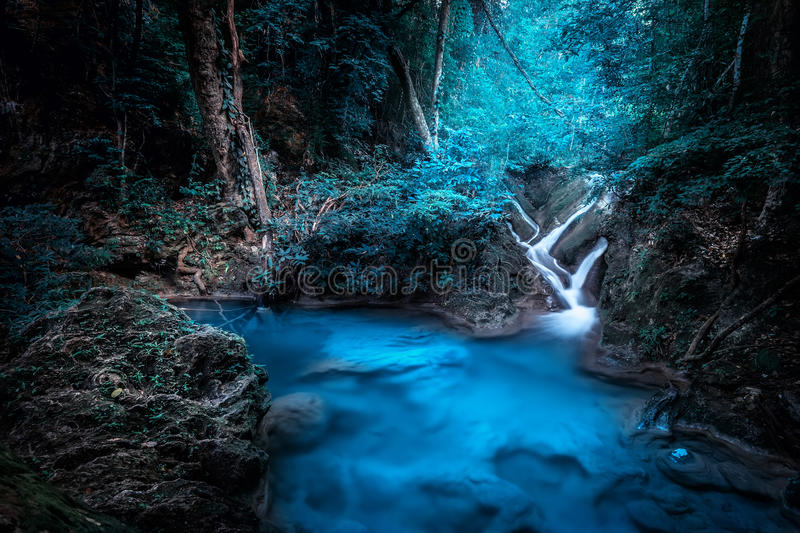 Mystery night at tropical forest with waterfall. Kanchanaburi, Thailand royalty free stock photo