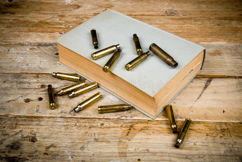 Mystery novels. Still life with old book and bullets, a mystery novel concept royalty free stock photo