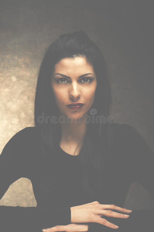 Mystery woman. Young mystery woman in black royalty free stock images