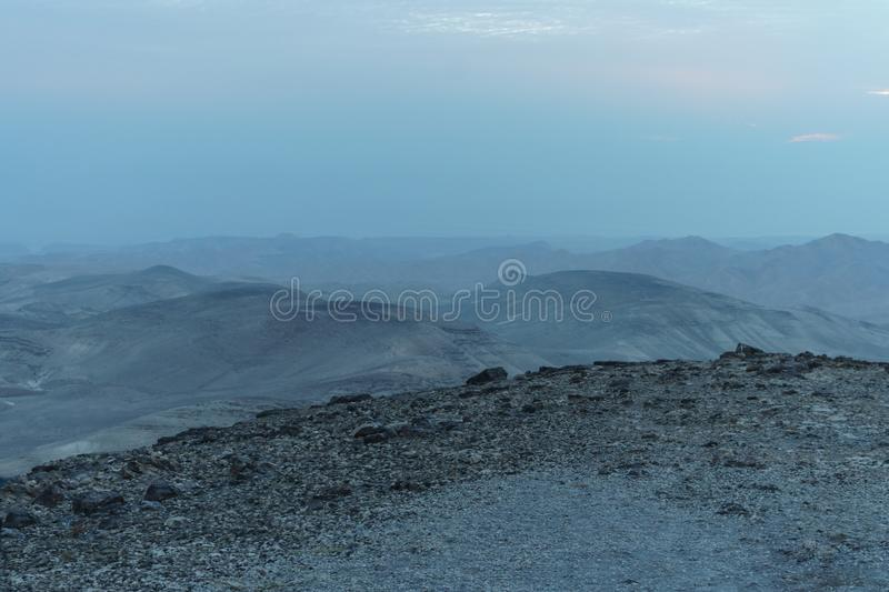Mystic blue morning landscape view on negev judean desert in Israel stock photo