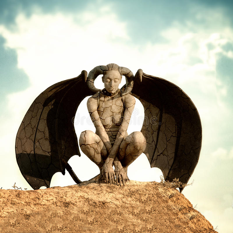 Mystic creature. Woman in body paint with the wings and horns royalty free stock photo