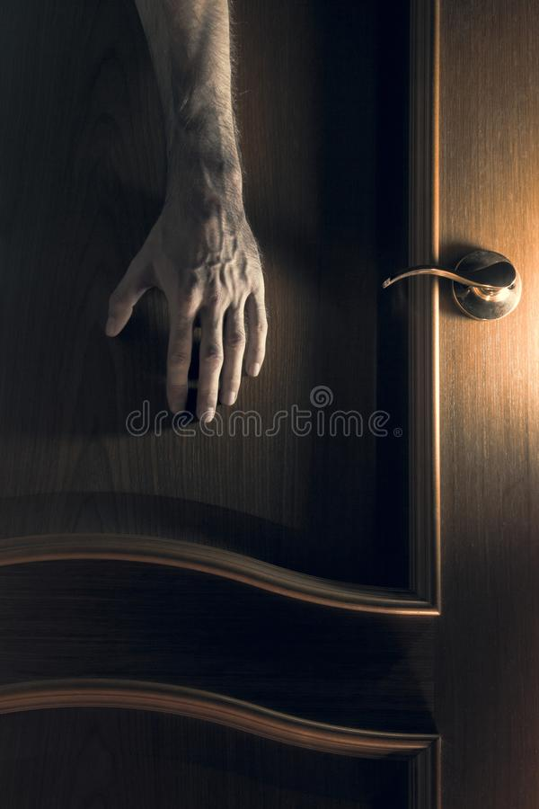 Mystic. The hand reaches for the door. royalty free stock image