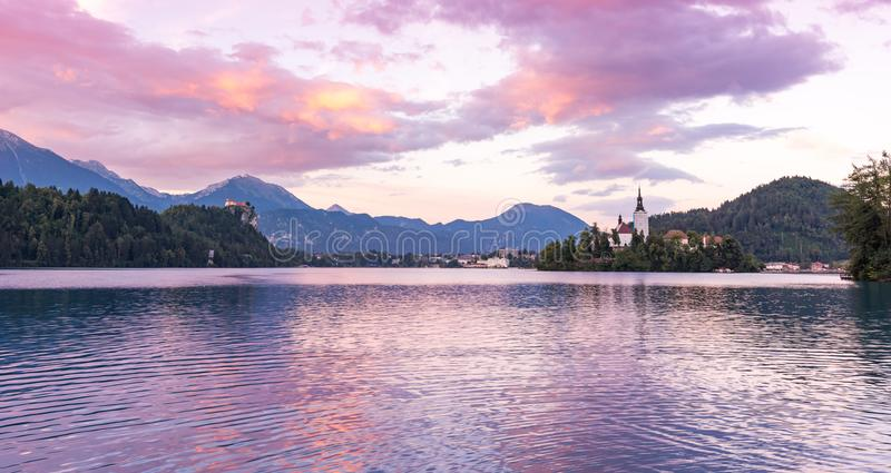 Mystic and magic sunset above the Bled lake, Slovenia. Beautiful magic purple colors and peaceful lake with church on the island. stock image