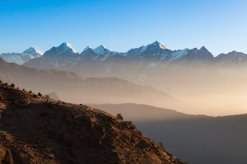 Mystic mountain sunrise scenery in Himalayas. stock photo