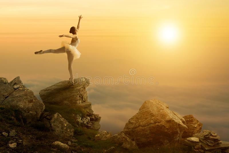 Mystic pictures, ballet dancer stands on the cliff edge.  stock photo