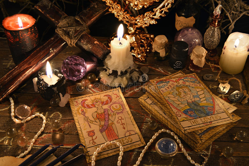 Mystic ritual with tarot cards, magic objects and candles royalty free stock image