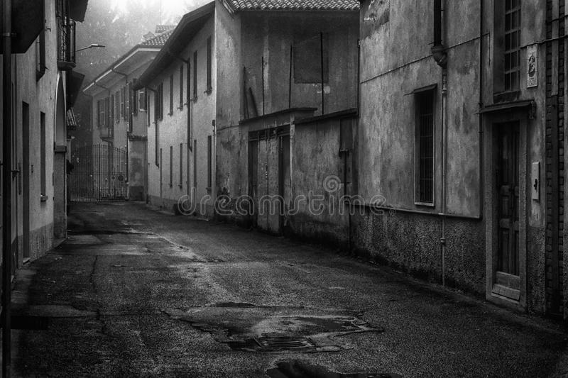 The mystic street in the city, foggy day in Italy.  stock images