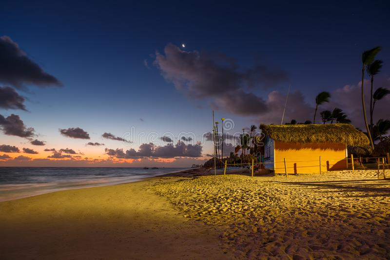 Mystic sunrise with moon and stars over the sandy beach in Punta Cana, Dominican Republic. Mystic sunrise with moon and stars in the sky over the sandy beach in stock photography