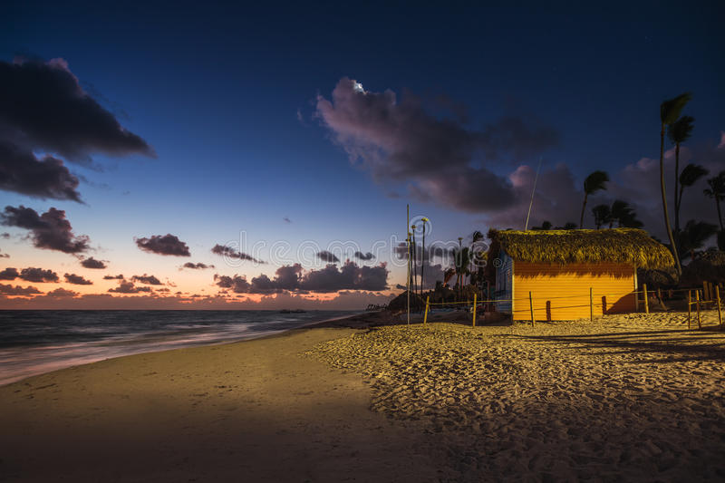 Mystic sunrise with moon and stars over the sandy beach in Punta Cana, Dominican Republic. Mystic sunrise with moon and stars in the sky over the sandy beach in royalty free stock image