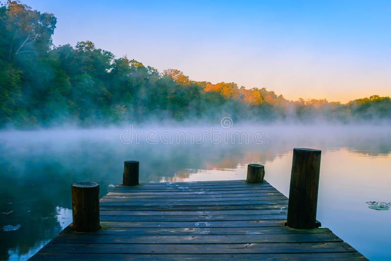 Mystic Water. Morning mist on reflective water, Mt Saint Francis, Indiana.ff royalty free stock photography