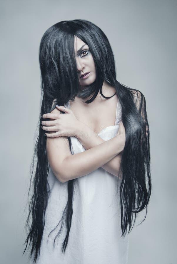 Mystical beautiful woman portrait. On gray background stock photos