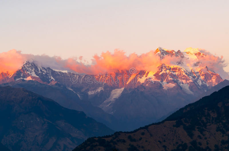 Mystical Chaukhamba peaks of Garhwal Himalayas during sunset from Deoria Tal camping site. royalty free stock photography