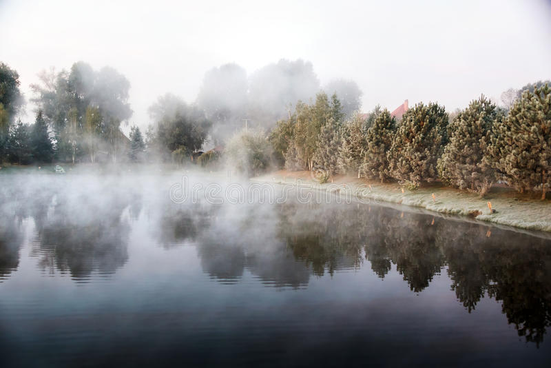 Mystical fog over the lake in the morning. Mystical fog over the lake in the morning stock photography