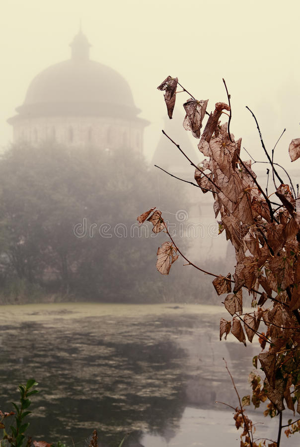 The mystical fog over the water. Mystical fog over the pond near the old monastery of the 17th century. Yaroslavl region , Russian Federation