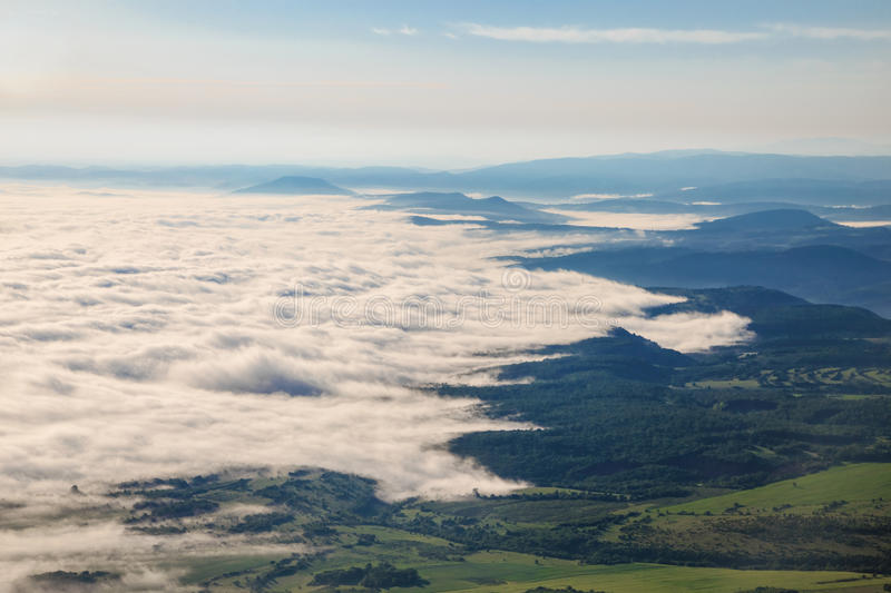Mystical fog in the spring. Image of mystical fog in the valley from above royalty free stock photo