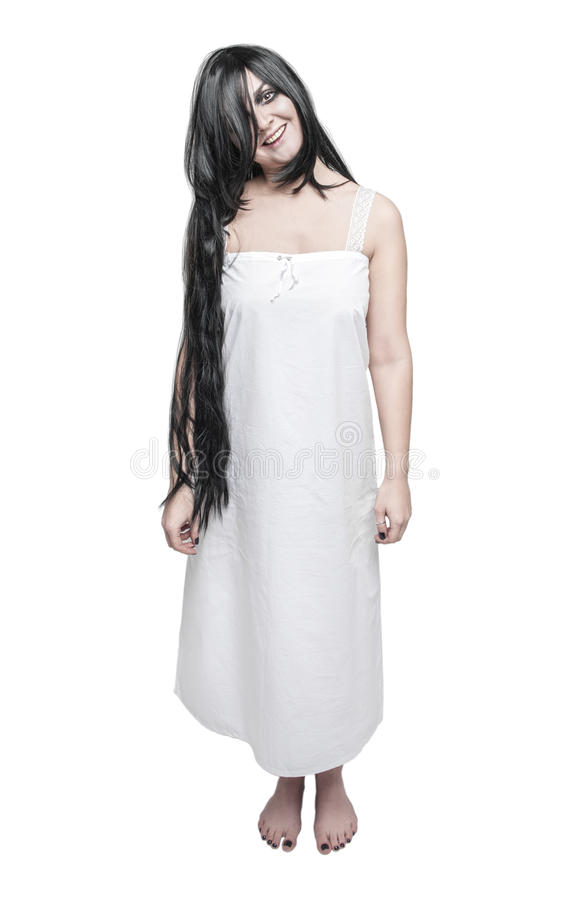 Mystical ghost crazy woman in white long shirt royalty free stock photo