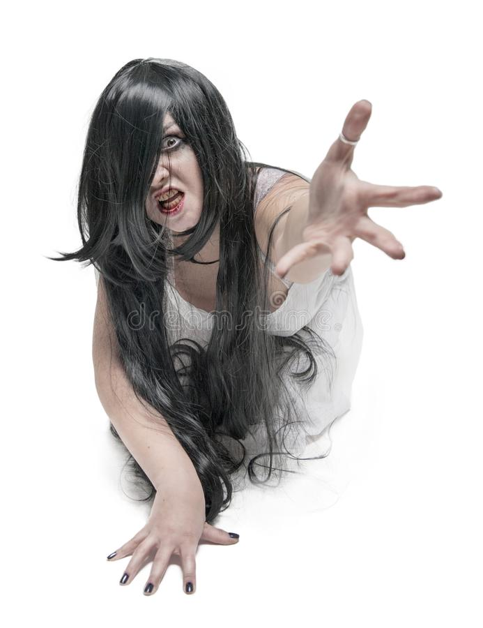 Mystical ghost woman in white long shirt reach out her hand. On white royalty free stock images