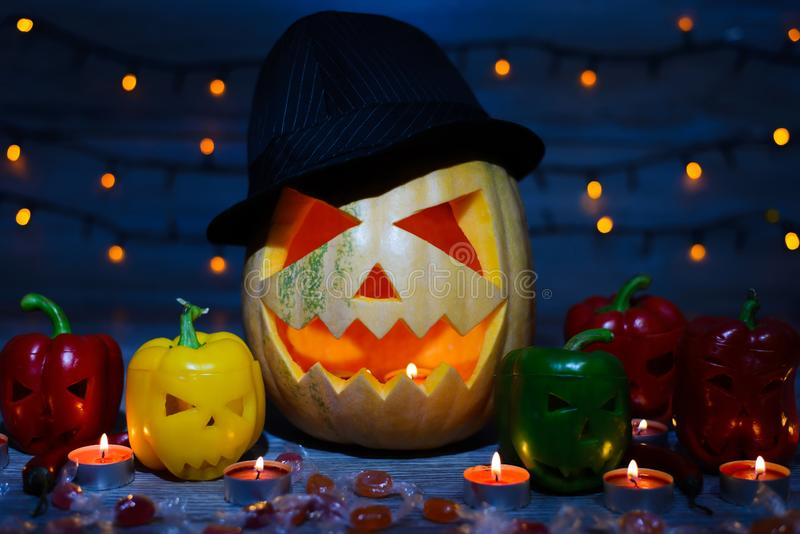 Mystical holiday. Trick or treat. Halloween pumpkin in a hat. Ca royalty free stock photo