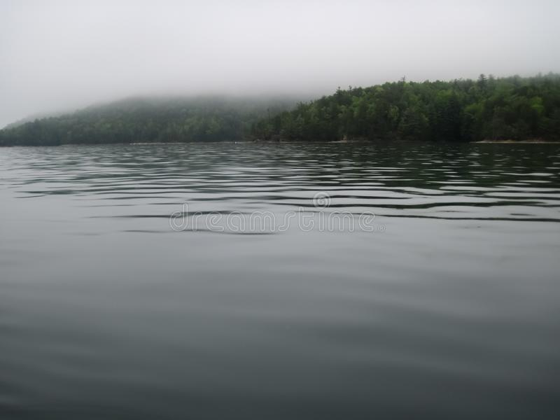 Mystical Lake Jocassee. Fog rolls in on a spring morning over Lake Jocassee stock photos