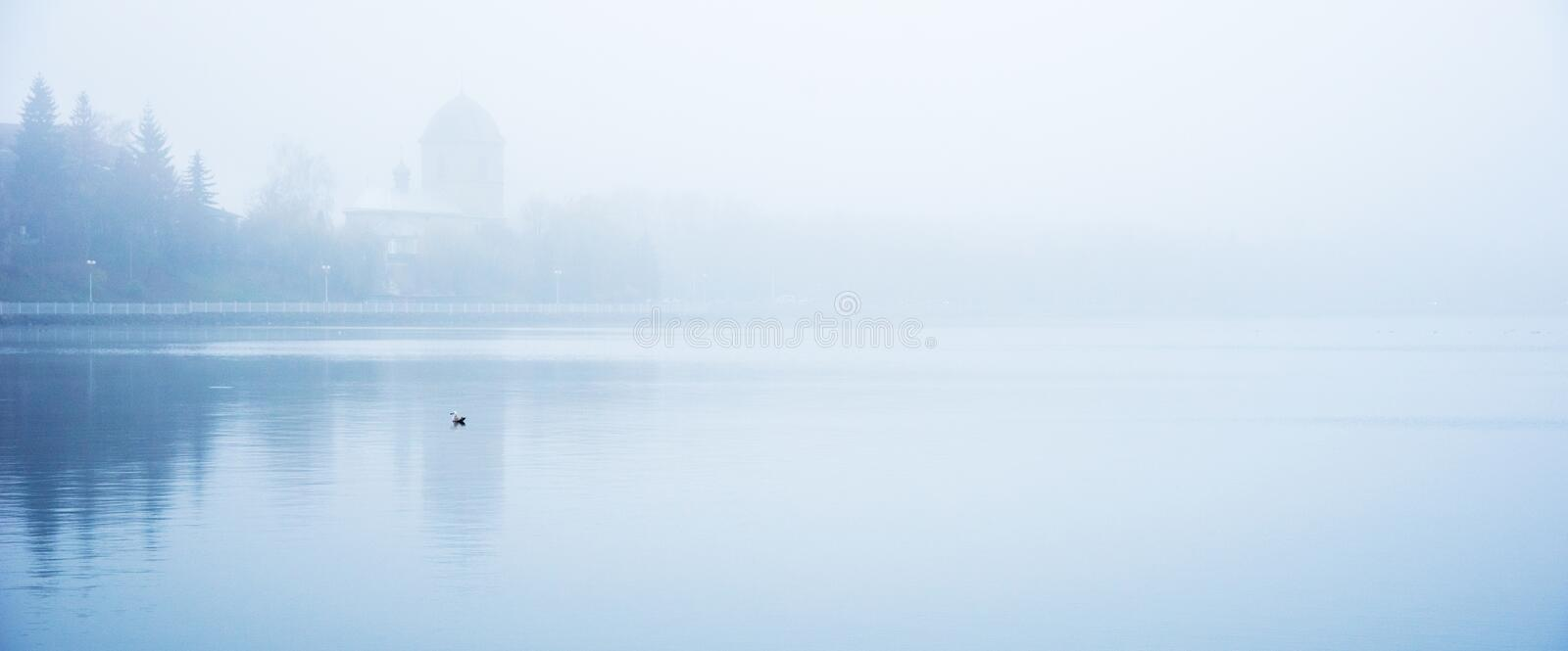 Mystical landscape with the old church above the lake in the misty morning in Ternopil, Ukraine stock images