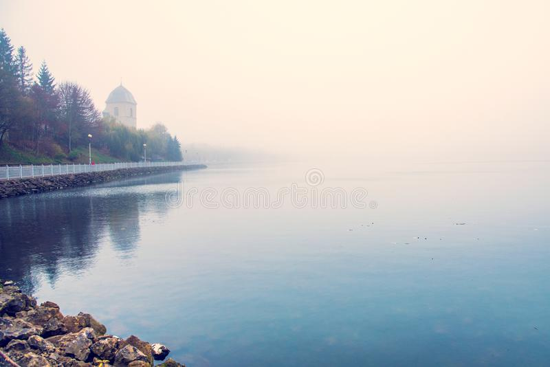 Mystical landscape with the old church above the lake in the misty morning in Ternopil, Ukraine.  stock images