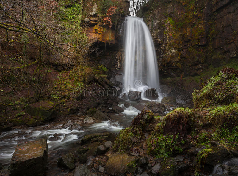 Mystical Melincourt waterfall. Melincourt waterfall in Resolven, near Neath, South Wales royalty free stock photo