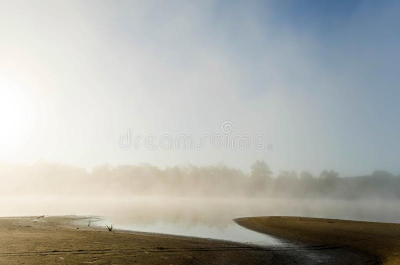 Mystical morning mist and haze over the river at dawn while fishing. Belarusian esie. Pripyat royalty free stock photos