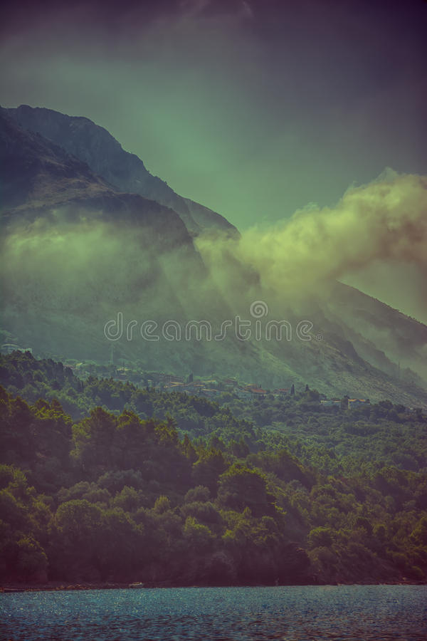 Mystical mountain's village landscape with fog. stock images