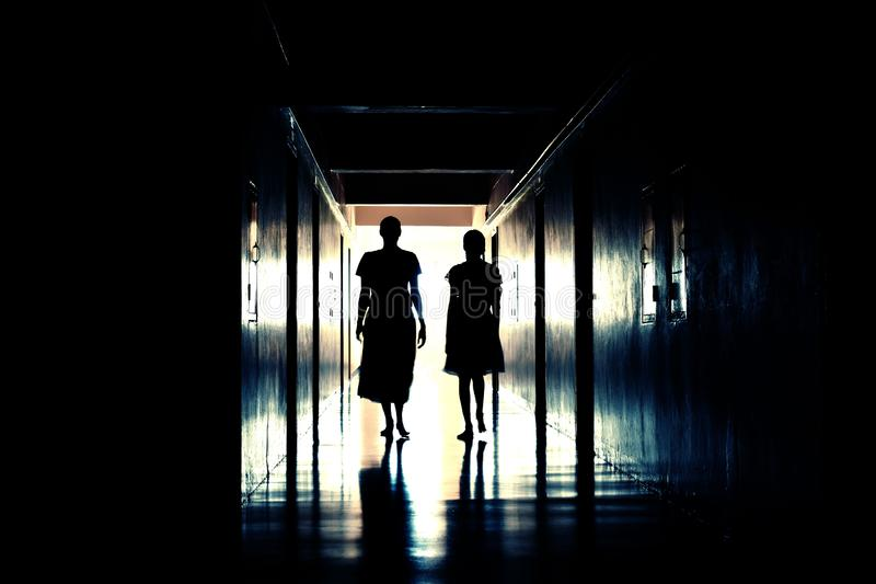 Mystical mysterious hallway with the ghosts. Bring the woman in the dark hall. Perfume dead scaring people people. Spooky house royalty free stock images