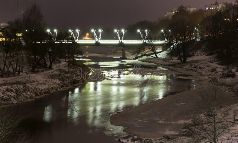 Mystical night landscape with illuminated bridge, blurred and misty outline, evening light, fog,. Gauja, Valmiera, Latvia royalty free stock photography