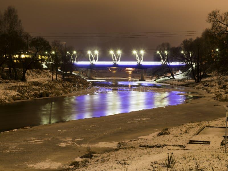 Mystical night landscape with illuminated bridge, blurred and misty outline, evening light, fog,. Gauja, Valmiera, Latvia royalty free stock image