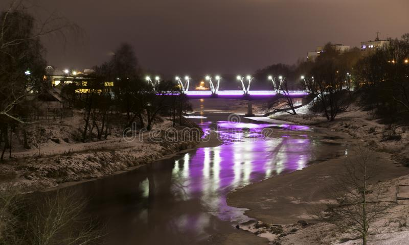 Mystical night landscape with illuminated bridge, blurred and misty outline, evening light, fog,. Gauja, Valmiera, Latvia stock photo