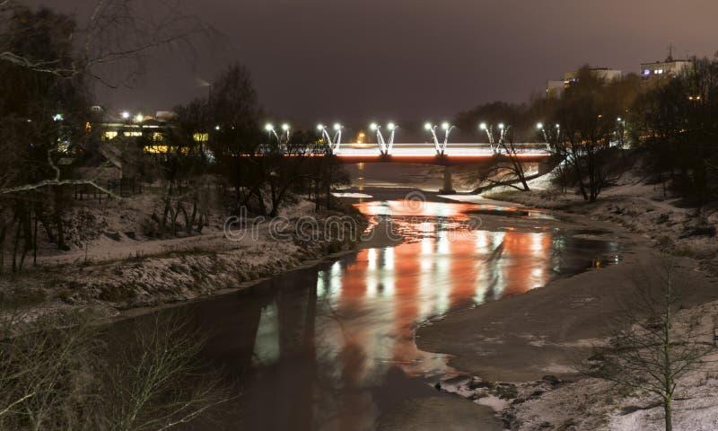 Mystical night landscape with illuminated bridge, blurred and misty outline, evening light, fog,. Gauja, Valmiera, Latvia royalty free stock images