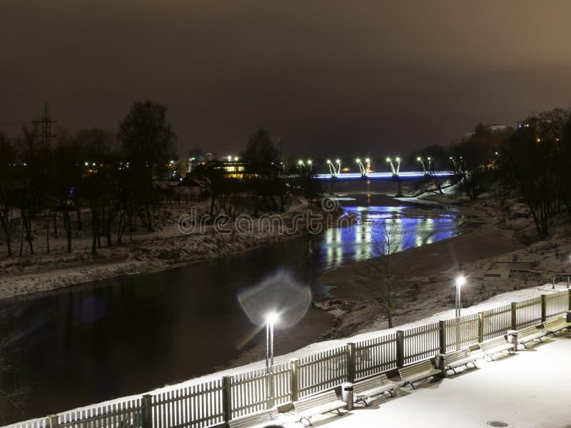 Mystical night landscape with illuminated bridge, blurred and misty outline, evening light, fog,. Gauja, Valmiera, Latvia stock image