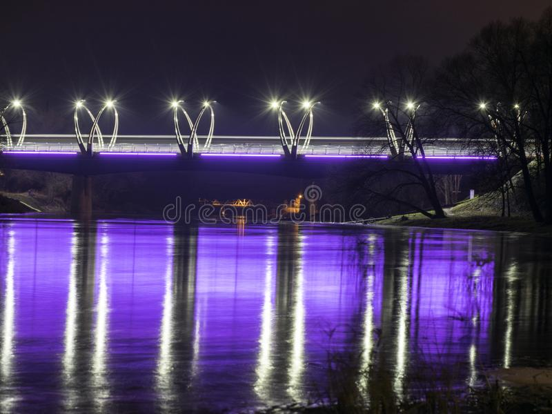 Mystical night landscape with illuminated bridge, blurred and misty outline, evening light, fog,. Gauja, Valmiera, Latvia stock images