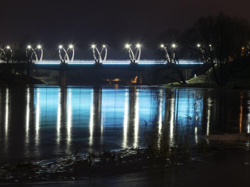 Mystical night landscape with illuminated bridge, blurred and misty outline, evening light, fog,. Gauja, Valmiera, Latvia royalty free stock photos