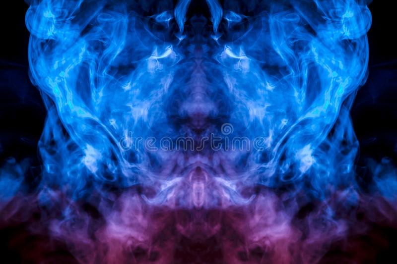 The mystical pattern of a person`s face from evaporating smoke in thin tongues is like a flame of blue on a black background. royalty free illustration