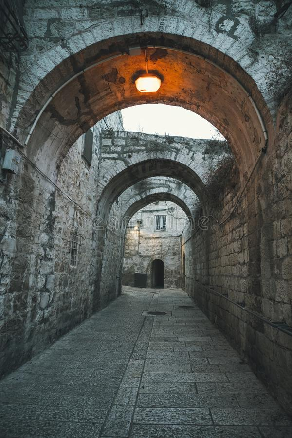 Mystical street at morning in the old city of Jerusalem. Old narrow streets in the quarter of Jerusalem.  stock photos